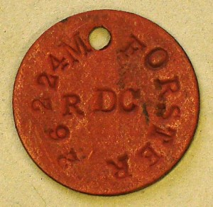 This red identity disc belonged to M. Forster of the Norfolk Regiment