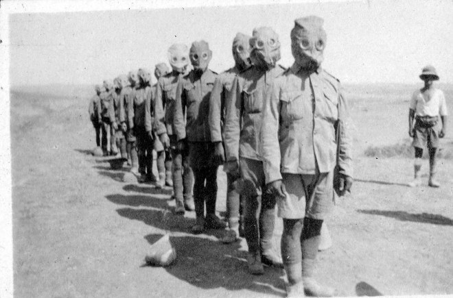 Soldiers of the Norfolk Regiment wearing gas masks.