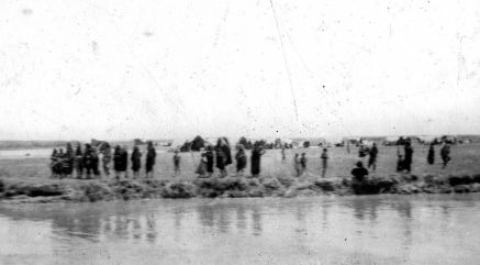 Arabs on a riverbank - probably the Euphrates. taken by G B Northcote