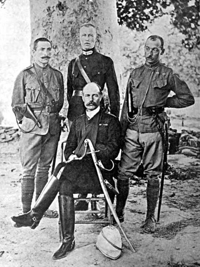 Surgeon-Major Robertson (seated) with, from left to right, Lieutenant Harley, Lieutenant Gurdon and Captain Townshend. from Robertson, Chitrál, the Story of a Minor Siege, 1898