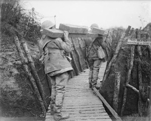British troops carrying timber up to the front line trenches (IWM).