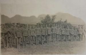 group of 1/4th Battalion Noroflk Regiment men seen stood together whilst serving in Egypt.