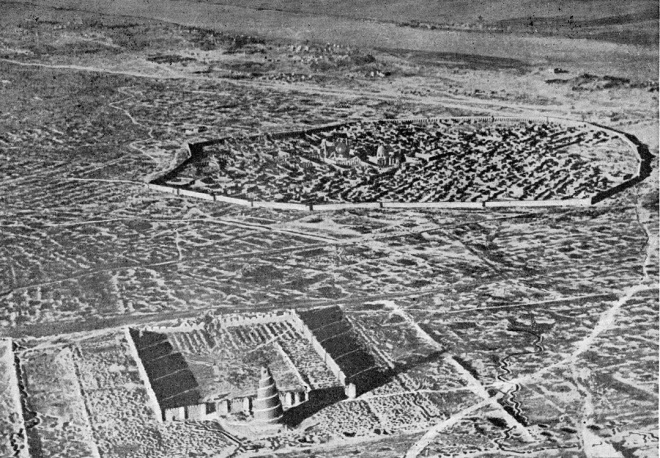Samarra from the air, c1922  In the foreground, the precincts of the Great Mosque of Samarra with its spiralling Malwiya Minaret; in the background, the River Tigris