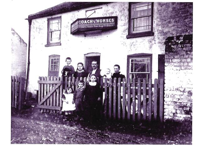 The Woods family outside their inn.